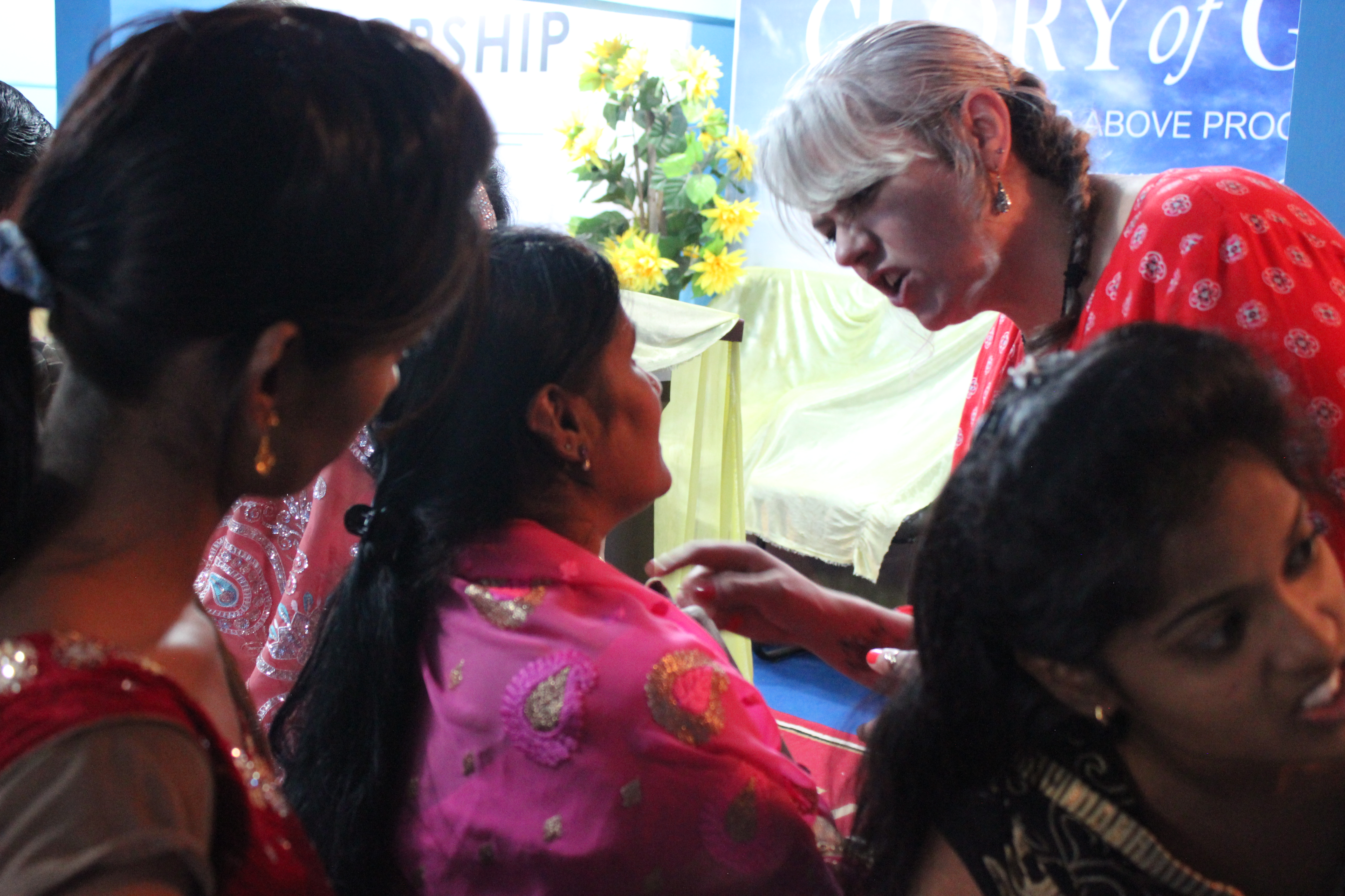 ministering to their needs...  the daughter was my interpreter..